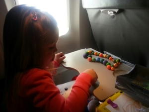 Playing with Play-Doh balls on a recent flight.