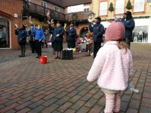 Little R, watching carolers in Farnham.
