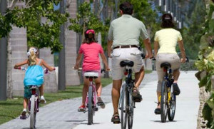 Family bike-riding in the Cayman Islands.