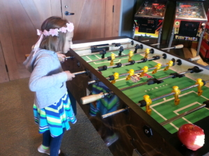 Our Big Girl tries her hand(s) at foosball.