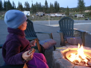 L eating s'mores, before the skies got dark.
