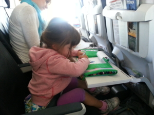 Little R, mid-flight, on her first diaper-free plane trip.