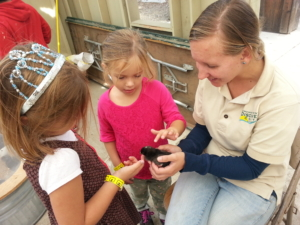 L and her BFF, petting a baby chicken on the class field trip.