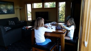 Sisters playing with perlers. 6 a.m.