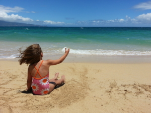 Years later, our beach babe still loves the crashing surf.